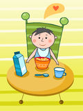 Criança que come um pequeno almoço Fotografia de Stock