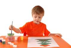 Criança que desenha um cartão de Natal Imagem de Stock