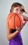 Criança que exercita com bola Fotos de Stock Royalty Free