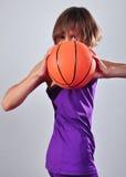 Criança que exercita com bola Imagem de Stock Royalty Free