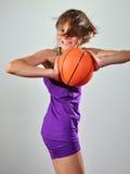 Criança que exercita com bola Fotografia de Stock