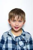 Criança que faz as caras engraçadas Imagens de Stock Royalty Free