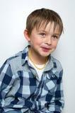 Criança que faz as caras engraçadas Fotografia de Stock