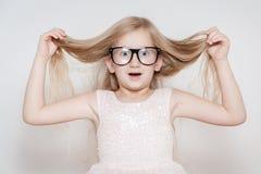 Criança que faz uma cara Foto de Stock Royalty Free