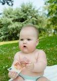 Criança que guarda o euro 10 Imagem de Stock