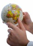 Criança que guarda um globo Imagens de Stock Royalty Free