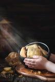 Criança que guarda uma bacia com cookies Imagens de Stock Royalty Free