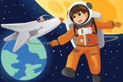 Criança que imagina como um astronauta Foto de Stock Royalty Free