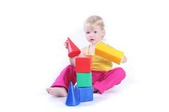 Criança que joga com brinquedo Imagem de Stock Royalty Free