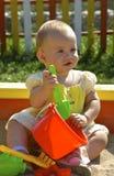 Criança que joga com brinquedos Fotografia de Stock