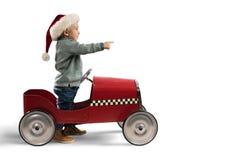 A criança que joga com seu carro espera Santa Claus Imagens de Stock Royalty Free