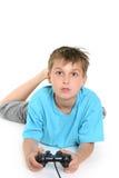 Criança que joga jogos de computador. Foto de Stock
