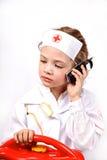 Criança que joga um doutor Fotografia de Stock Royalty Free