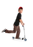 Criança que monta um 'trotinette' Imagem de Stock