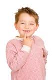 Criança que mostra fora seus dentes perdidos Imagens de Stock