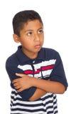 Criança que olha acima de pensamento Imagem de Stock