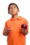 Criança que pede a sabedoria escolher o alimento Fotos de Stock Royalty Free