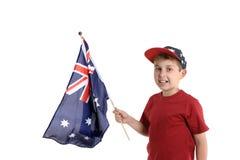 Criança que prende uma bandeira fotos de stock