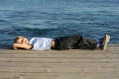 criança que relaxa, férias Fotografia de Stock