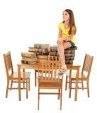 Criança que senta-se na tabela dos livros Foto de Stock