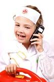 Criança que tem o divertimento de jogar um doutor Fotos de Stock
