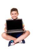 Criança que usa um computador Imagens de Stock Royalty Free
