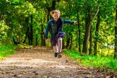 Criança running Fotos de Stock Royalty Free