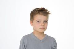 Criança séria no fundo branco Imagem de Stock