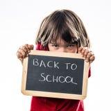 Criança tiranizada que esconde contra um assustador de volta à escola Fotografia de Stock