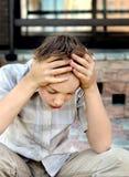Criança triste exterior fotografia de stock royalty free