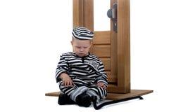 Criança vestida como o ladrão Fotos de Stock Royalty Free