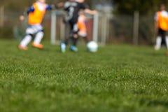 Crianças borradas do futebol Fotografia de Stock