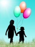 Crianças com balões Fotos de Stock Royalty Free