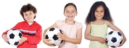 Crianças com esfera de futebol Fotos de Stock Royalty Free