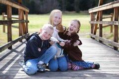 Crianças com filhote de cachorro Fotos de Stock Royalty Free