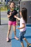Crianças com o Lollipop no campo de jogos Fotografia de Stock Royalty Free