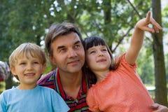 Crianças com seu tio Fotografia de Stock Royalty Free