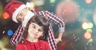 Crianças completamente do espírito do Natal Fotos de Stock