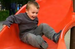 Crianças de Slidding Fotografia de Stock