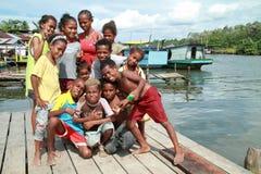 Crianças deficientes em um porto pequeno Foto de Stock Royalty Free