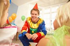 Crianças divertidos do palhaço no partido Fotografia de Stock Royalty Free