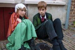 Crianças do festival de Dickens que são música de natal fria do Natal Fotos de Stock