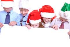 Crianças do Natal com uma bandeira imagens de stock royalty free