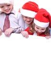 Crianças do Natal com uma bandeira Fotos de Stock Royalty Free
