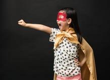 Crianças do super-herói em um fundo preto Imagem de Stock Royalty Free