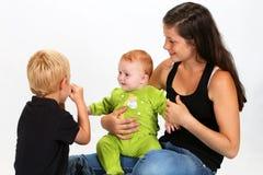 Crianças e baby-sitter Fotos de Stock