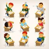Crianças em mesas Imagens de Stock Royalty Free
