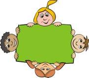 Crianças em torno do bilboard Imagem de Stock