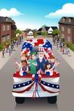 Crianças em uma parada que comemoram o quarto de julho Imagens de Stock Royalty Free