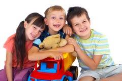 Crianças felizes com brinquedos Imagens de Stock Royalty Free